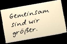 """Auf einem Zettel steht: """"Gemeinsam sind wir größer."""""""