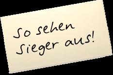 """Auf einem Zettel steht: """"So sehen Sieger aus!"""""""